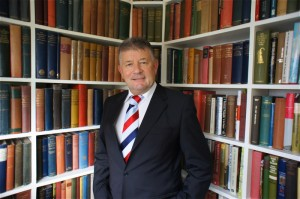 Jonathan Nicholls in his library